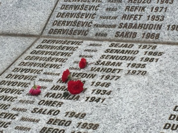 Flowers resting on memorial for lives lost in Srebrenica.